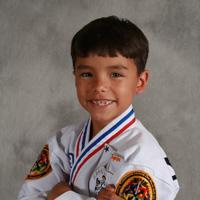 karate kid with arms crossed